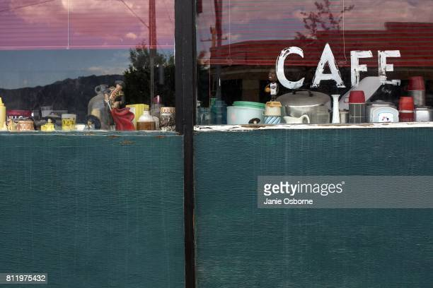 A view of a cafe window in downtown Butte on July 6 2017 in Butte Montana Formerly an open pit copper mine today the Berkeley Pit is part of the...