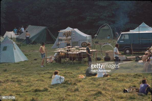 View of a camping area and large collection of percussion instruments near the 'Free Stage' at the Woodstock Music and Arts Fair Bethel New York...