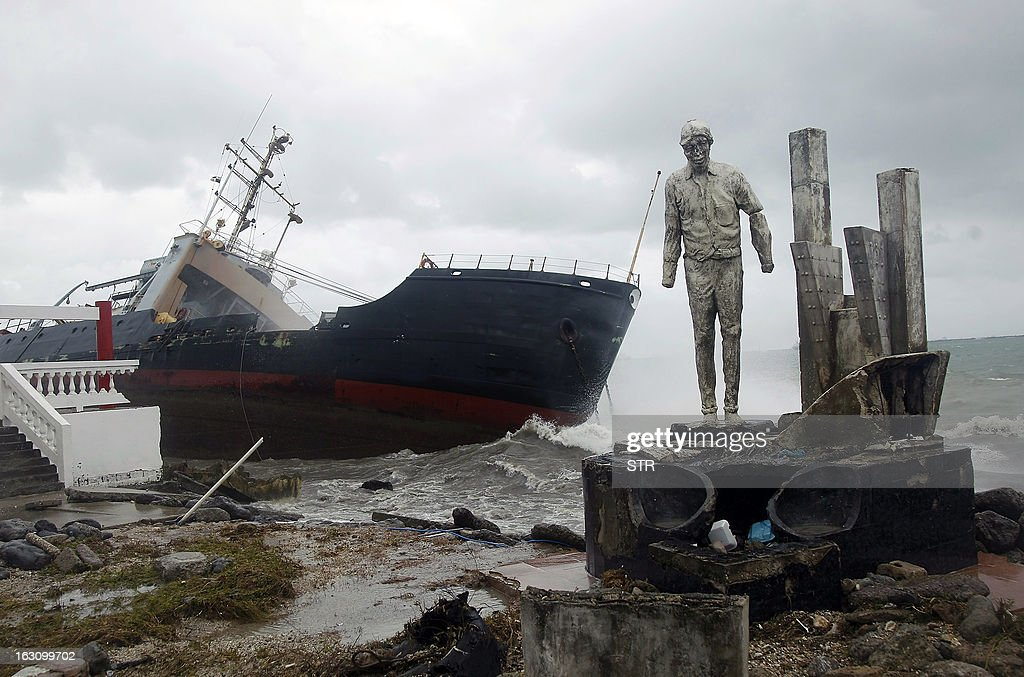 View of a cargo ship stranded on the shore of Colon city on the Atlantic Ocean, on March 4, 2013. Six cargo ships run aground following heavy rains, winds and huge waves due to a cold front from the north on the Panama Caribbean.