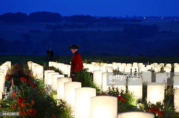 A view of a Chelsea pensioner amongst military graves illuminated during part of a militaryled vigil to commemorate the 100th anniversary of the...
