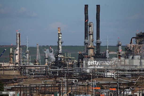 A view of a Chevron refinery on March 3 2015 in Richmond California US gas prices have surged an average of 39 cents in the past 35 days as a result...