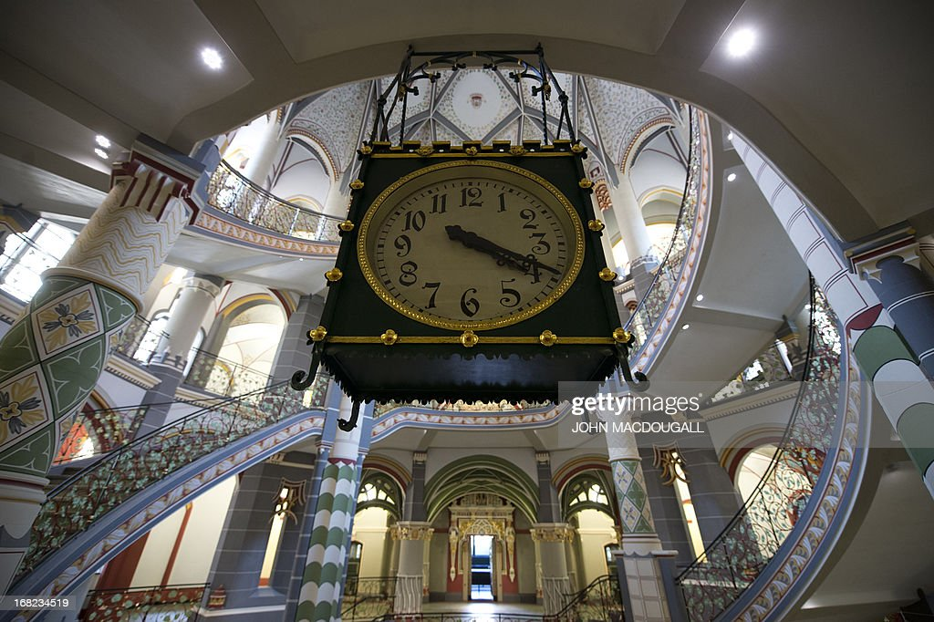 View of a clock in the main stairwell in the newly restored regional court house (Landgericht) in Halle, eastern Germany, on May 6, 2013. The neo-Baroque building, which combines Gothic, Renaissance and Art Nouveau styles, was completed in 1905. The building's 20 courtrooms, 110 offices were painstakingly renovated over a two-year period, and will officially reopen for business in May 2013.