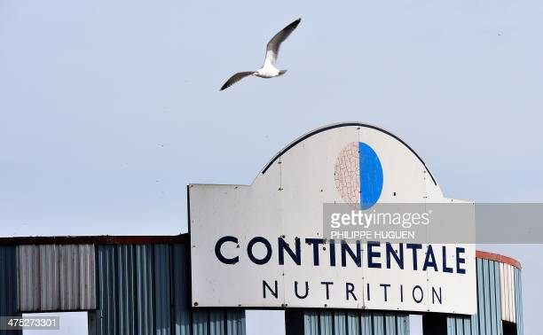 A view of a company sign atop the Continentale Nutrition factory in BoulognesurMer on February 27 2014 One of the two prospective buyers of...