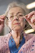 Woman choosing eyeglasses