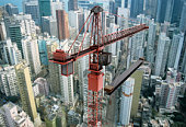 View of a construction crane and cityscape