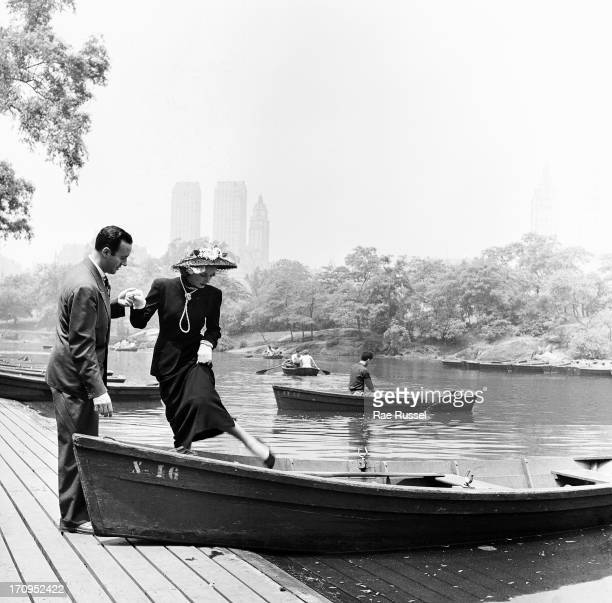 View of a couple a welldressed man and woman as they enjoy boating on one of the ponds in Central Park New York New York 1948