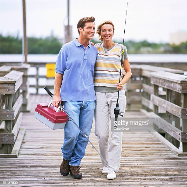 view of a couple at a pier on a fishing trip