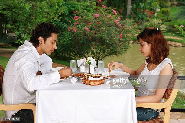 View of a couple having lunch