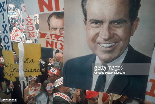 View of a crowd of people holding up signs in support of Republican presidential candidate Richard M Nixon at the 29th Republican National Convention...