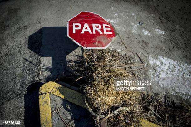 View of a damaged traffic sign at Tongoy sea ressort 400 kilometres north of Santiago hit by an earthquake on the eve on September 17 2015 Rattled...