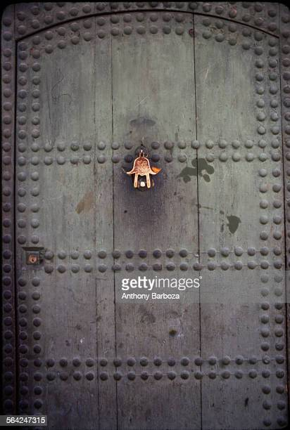 View of a dark wooden door with a metal knocker Morocco 1980s