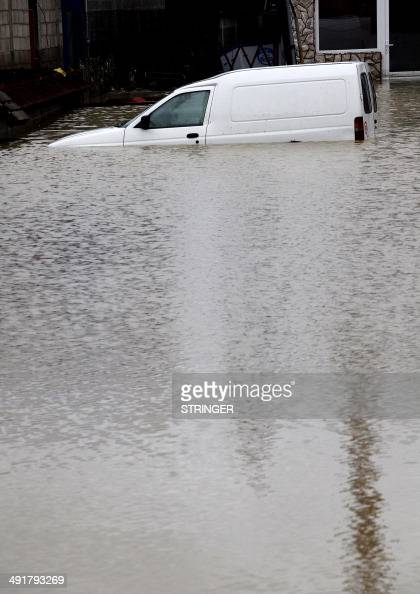 A view of a delivery van in the flooded streets in the WesternBosnian town of Banja Luka on May 17 2014 The heaviest rains in more than a century...