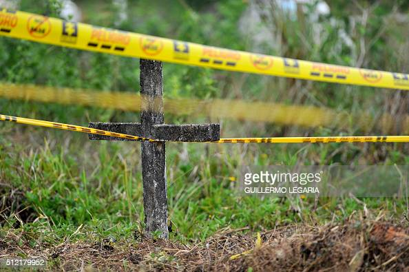 View of a demarcated area during the exhumation of unidentified bodies buried in the cemetery of La Macarena Colombia on February 24 2016 Staff of...