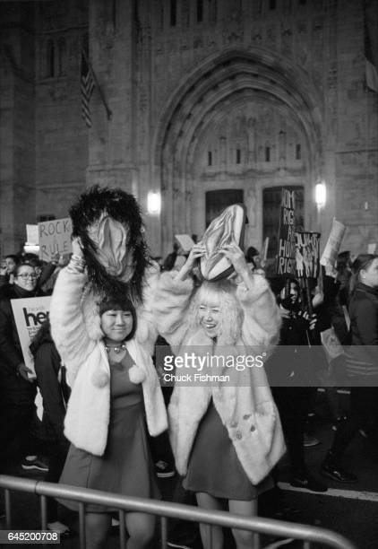 View of a demonstrator as she holds a model of a vagina over her head on Fifth Avenue during the Women's March on New York New York New York January...