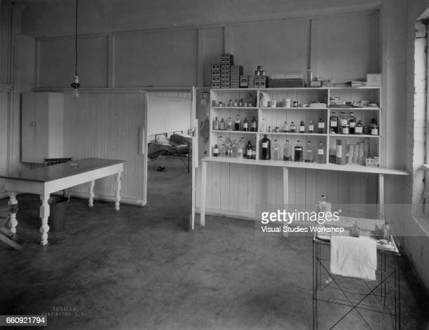 View of a deserted medical supply room and in the room beyond a row of cots Huntington West Virginia December 27 1936