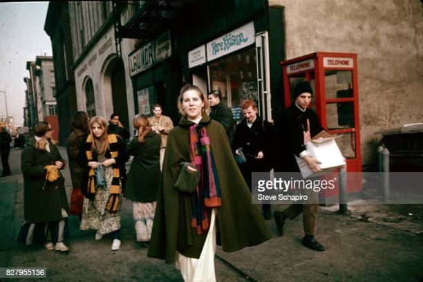 View of a devotees of the International Society for Krishna Consciousness better known as Hare Krishna as they stand outside their storefront temple...