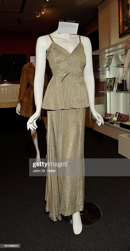 A view of a dress worn by actress Jean Harlow at the press preview for Icons & Idols Fashion and Hollywood Exhibit at Julien's Auctions Gallery on November 5, 2013 in Los Angeles, California.
