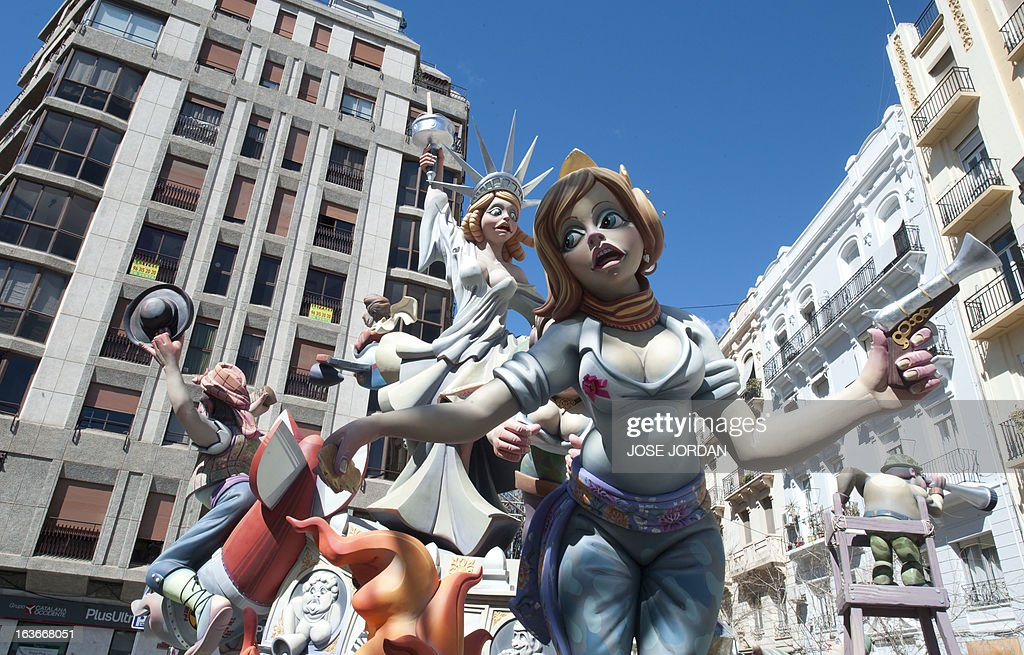 View of a Falla, a gigantic sculpted satirical structure made of cardboard, taken during preparations for the Fallas Festival ,on March 14, 2013 in Valencia. The Fallas will be burned in the streets of Valencia on March 19, 2013, as a tribute to St Joseph, patron saint of the carpenters' guild.