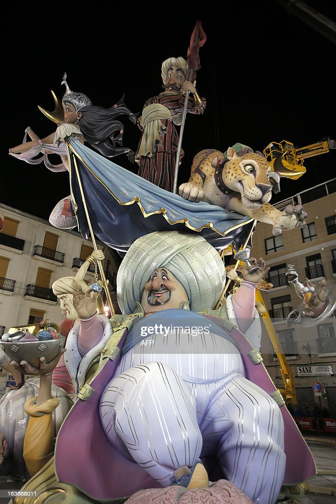 View of a Falla, a gigantic sculpted structure made of cardboard which portrays current events and personalites taken during preparations for the Fallas Festival ,on March 13, 2013 in Valencia. The Fallas will be burned in the streets of Valencia on March 19, 2013, as a tribute to St Joseph, patron saint of the carpenters' guild.