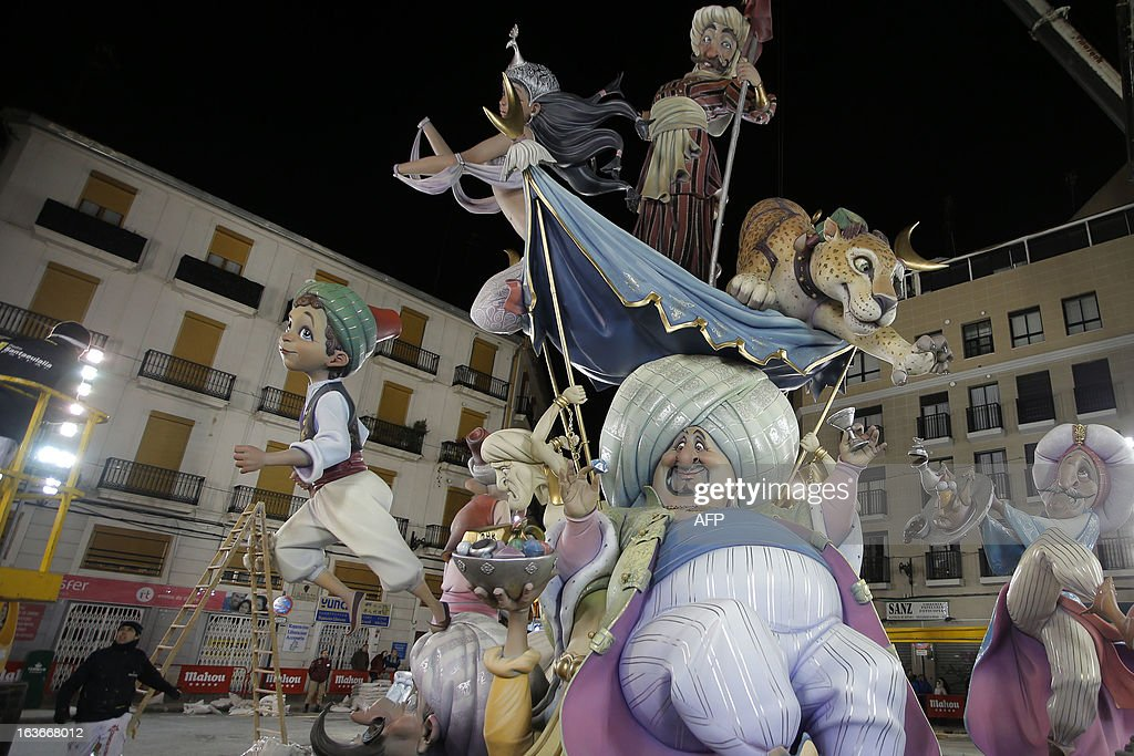 View of a Falla, a gigantic sculpted structure made of cardboard which portrays current events and personalites taken during preparations for the Fallas Festival ,on March 13, 2013 in Valencia. The Fallas will be burned in the streets of Valencia on March 19, 2013, as a tribute to St Joseph, patron saint of the carpenters' guild. AFP PHOTO / JOSE JORDAN