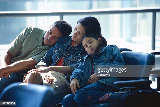 view of a family sitting on chairs and sleeping
