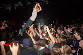 A view of a fan diving off the stage into the crowd as The Word Alive performs in concert behind him at The Emerson Theater on January 5 2011 in...