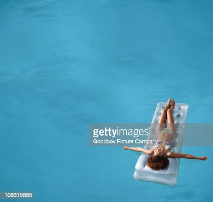 View of a female floating in swimming pool