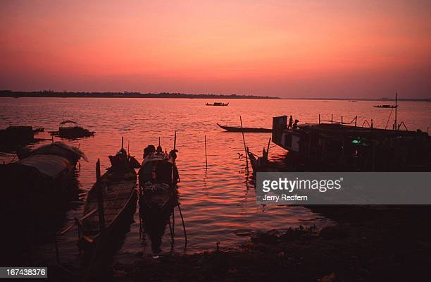 View of a floating Cham Muslim fishing village across from Phnom Penh at sunrise