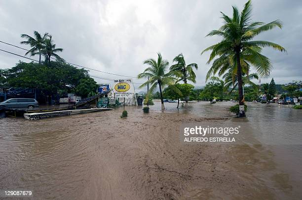 View of a flooded avenue following the passage of Jova Hurricane in the region in Manzanillo Colima State Mexico on October 12 2011 Jova lost its...