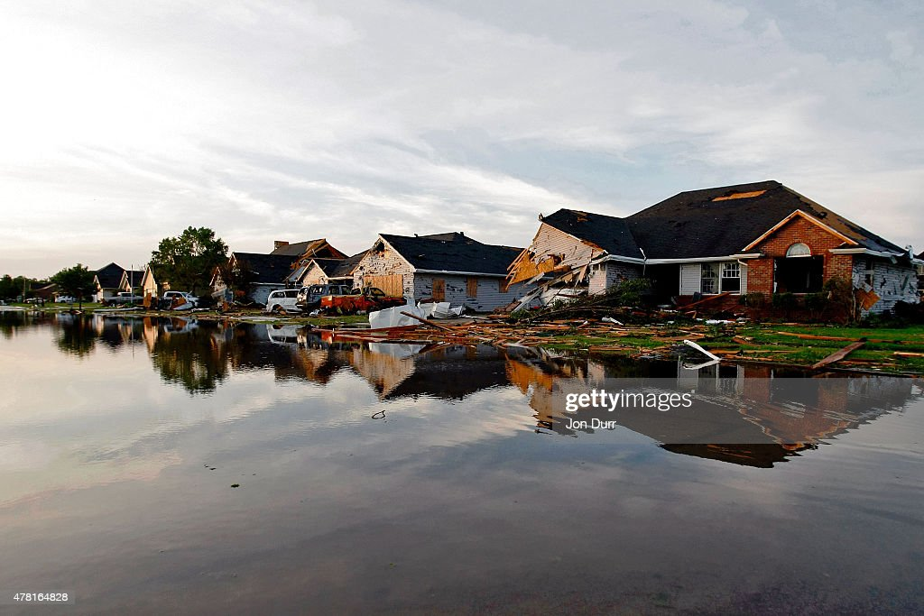 A view of a flooded street and damaged homes on W Daisy Place after a tornado struck the previous day on June 23 2015 in Coal City Illinois