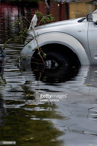 View of a flooded street as the water starts subsiding in La Plata located 63 km south of Buenos Aires on April 3 2013 after a powerful storm that...