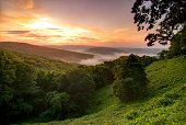 View of a sunrise in the Ozark Mountains, Arkansas. Overlook of foggy mountains in the sun.