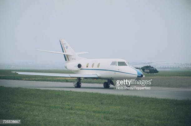 View of a French built Dassault Falcon 10 corporate business jet aircraft taxiing along a runway at Le Bourget Airport during the 1971 Paris Air Show...