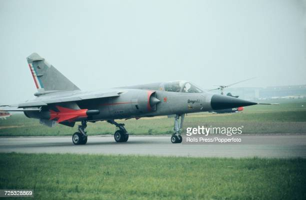 View of a French built Dassault Mirage F1 jet fighter attack aircraft taxiing along a runway at Le Bourget Airport during the 1971 Paris Air Show in...