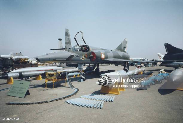 View of a French built Dassault Mirage III Milan jet fighter aircraft on static display with associated weaponry and ordnance at Le Bourget Airport...