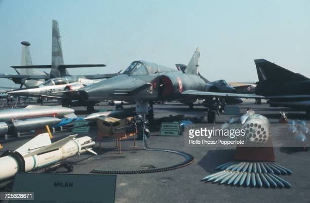 View of a French built Dassault Mirage IIIE multirole strike jet fighter aircraft on static display with assorted weaponry at Le Bourget Airport...