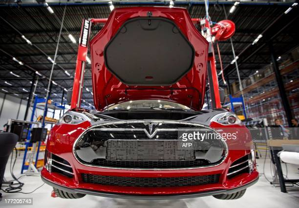 A view of a fully electric Tesla car on an assembly line at the new Tesla Motors car factory in Tilburg the Netherlands during the opening and launch...