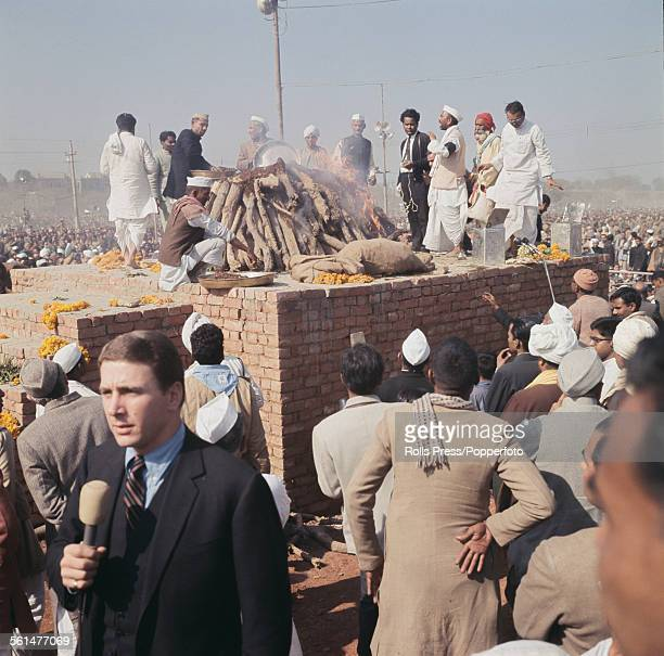 View of a funeral pyre containing the body of Indian Prime Minister Lal Bahadur Shastri during a ritual cremation ceremony in New Delhi India in...