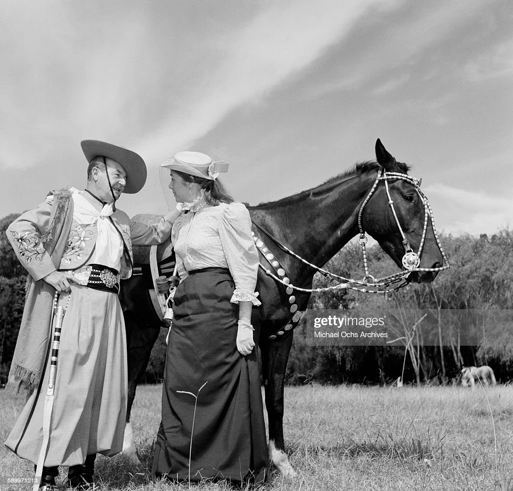 A view of a Gaucho dressed in traditional attire talks with a woman at the the Patria Grande Festival in Montevideo Uruguay