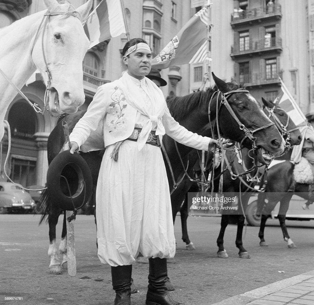A view of a Gaucho holding two horses at the Patria Grande Festival in Montevideo Uruguay