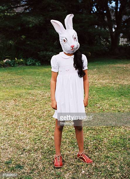 view of a girl (8-10) wearing a rabbit mask on her face
