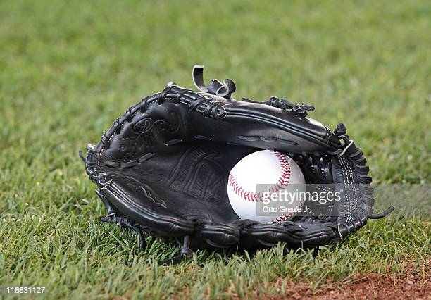 A view of a glove and ball prior to the game between of the Seattle Mariners against the Los Angeles Angels of Anaheim at Safeco Field on June 15...