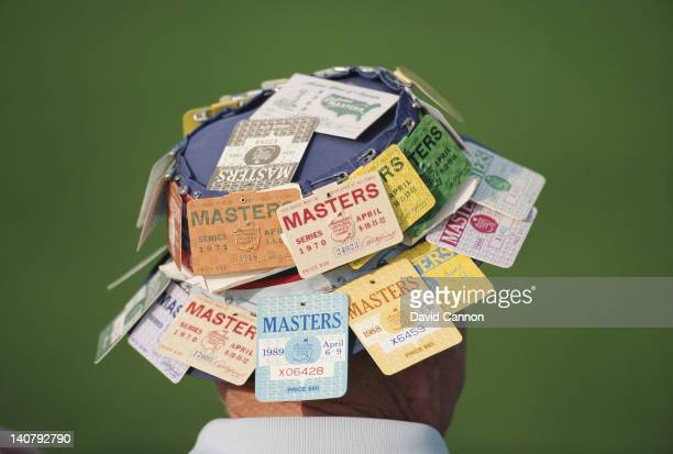 View of a golf fan with his hat adorned with tickets from previous Masters events during the US Masters Golf Tournament on 9th April 1992 at the...