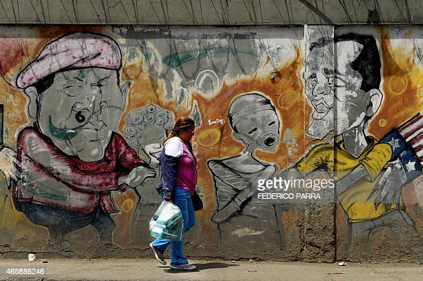 View of a graffiti depicting late Venezuelan President Hugo Chavez and at right somebody who might be Venezuelan opposition leader Leopoldo Lopez in...
