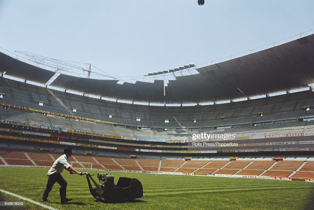 View of a groundsman cutting the grass with a lawnmower inside the recently completed Estadio Azteca (Azteca Stadium) in Mexico City, Mexico in 1967. The stadium would go on to be used to host the football tournament of the 1968 Summer Olympics and the 1970 World Cup final.