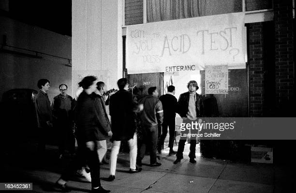 View of a group of young people lined up outside an 'Acid Test' set up to explore the use of LSD Los Angeles California 1966 The 'Acid Tests' were of...