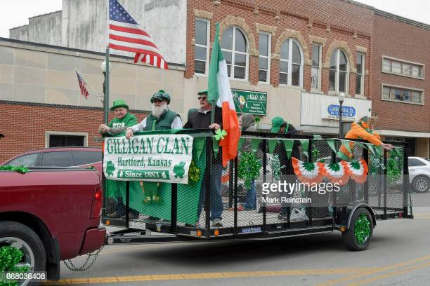View of a group people who ride in a trailer during the annual Saint Patrick's Day Parade Emporia Kansas March 11 2017 Their sign reads 'Gilligan...