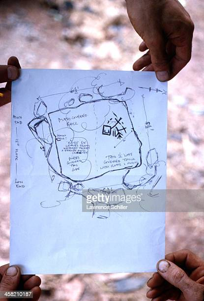 View of a hand drawn map held by divers as they discuss plans near Cocos Island off the coast of Costa Rica 1964