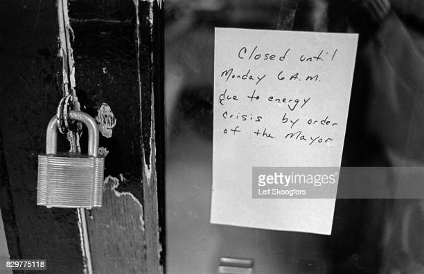 View of a handwritten note on the padlocked door of an unidentified restaurant Philadelphia Pennsylvania July 1973 The sign reads 'Closed unil Monday...