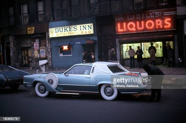 View of a heavily customized 1973 Cadillac Eldorado 'pimpmobile' parked on a street in Harlem New York New York 1970s